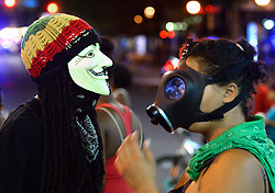 Protesters mingle near the intersection of Trade and College Streets Saturday, September 24, 2016 in Charlotte, NC, USA. Protesters came together for the fifth straight night to protest following the fatal shooting of Keith Lamont Scott. Keith Lamont Scott was shot and killed by Charlotte-Mecklenburg Police Officer Brentley Vinson on Tuesday afternoon. Photo by Jeff Siner/Charlotte Observer/TNS/ABACAPRESS.COM
