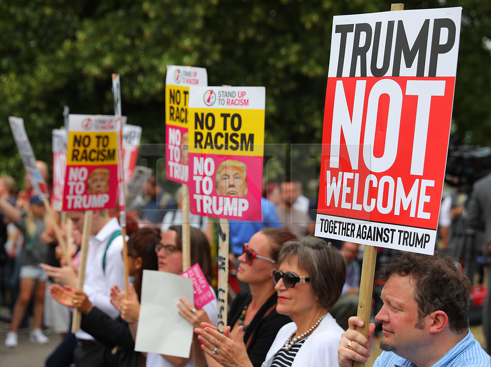 © Licensed to London News Pictures. 12/07/2018. London, UK. Protesters outside Winfield House, the American Ambassador's residence in Regents Park, as President of the United States Donald Trump visits the United Kingdom. Photo credit: Rob Pinney/LNP