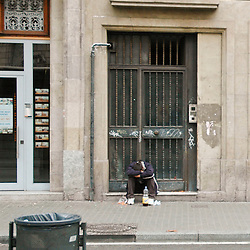 A party goer recovering from the night before is not an unusual scene early in the morning along La Rambla.