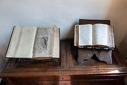 Old books on display inside  Gladstones Land historic building on Royal Mile in Old Town of Edinburgh, Scotland, Uk