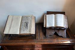Old books on display inside  Gladstones Land historic building on Royal Mile in Old Town of Edinburgh, Scotland, Uk