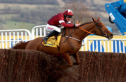 Balko Des Flos ridden by jockey Davy Russell goes on to win the Ryanair Chase during St Patrick's Thursday of the 2018 Cheltenham Festival at Cheltenham Racecourse.