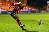 Lincoln City Forward Remy Howarth (17) crosses during the EFL Sky Bet League 1 match between Lincoln City and Shrewsbury Town at Sincil Bank, Lincoln, United Kingdom on 15 December 2020.