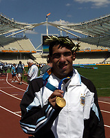 28/08/04 - ATHENS - GREECE -  - OLYMPIC FOOTBALL - FINAL MATCH - MENS  -  <br />ARGENTINA (1) Vs. PARAGUAY (0) At the Olympic Stadium in Athens. Argentine win the goal medal<br />Argentine players celebration. Here CARLOS TEVEZ with his GOLD MEDAL.<br />© Gabriel Piko / Argenpress.com / Piko-Press
