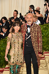 Christian Louboutin with guest attending the Costume Institute Benefit at The Metropolitan Museum of Art celebrating the opening of Heavenly Bodies: Fashion and the Catholic Imagination. The Metropolitan Museum of Art, New York City on May 7, 2018. Photo by Lionel Hahn/ABACAPRESS.COM