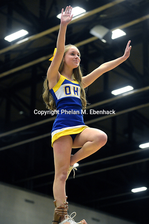 The Osceola cheerleaders perform during the semi-final game against Oviedo at the FHSAA Class 7A Boys Basketball Finals, Friday, Feb. 27, 2015, in Lakeland, Fla. Osceola won 67-55. (Photo by Phelan M. Ebenhack)