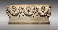 """Picture of Roman relief sculpted Sarcophagus of Garlands, 2nd century AD, Perge. This type of sarcophagus is described as a """"Pamphylia Type Sarcophagus"""". It is known that these sarcophagi garlanded tombs originated in Perge and manufactured in the sculptural workshops of Perge. Antalya Archaeology Museum, Turkey.. Against a grey background. .<br /> <br /> If you prefer to buy from our ALAMY STOCK LIBRARY page at https://www.alamy.com/portfolio/paul-williams-funkystock/greco-roman-sculptures.html . Type -    Antalya    - into LOWER SEARCH WITHIN GALLERY box - Refine search by adding a subject, place, background colour, etc.<br /> <br /> Visit our ROMAN WORLD PHOTO COLLECTIONS for more photos to download or buy as wall art prints https://funkystock.photoshelter.com/gallery-collection/The-Romans-Art-Artefacts-Antiquities-Historic-Sites-Pictures-Images/C0000r2uLJJo9_s0"""