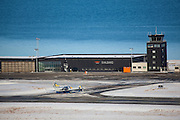 West Air Europe plane arriving at Longyearbyen Airport, on the Arctic island of Spitsbergen, Svalbard. It's the northernmost airport with scheduled flights in the world. Built on permafrost, the runway is insulated so that it won't melt in summer.