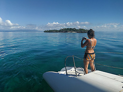 Tourist taking photos with smartphone. Calm Caribbean sea near cayo Iguana, Cuba. Small tropical island.