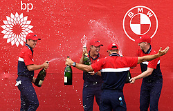 Team USA team celebrate winning the Ryder Cup trophy after victory against Team Europe at the end of day three of the 43rd Ryder Cup at Whistling Straits, Wisconsin. Picture date: Sunday September 26, 2021.
