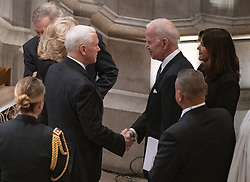 United States Vice President Mike Pence, left, shakes hands with former US Vice President Joe Biden, right, prior to the start of the National funeral service in honor of the late former United States President George H.W. Bush at the Washington National Cathedral in Washington, DC on Wednesday, December 5, 2018.<br /> Photo by Ron Sachs / CNP/ABACAPRESS.COM