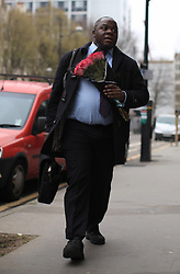 © Licensed to London News Pictures . 11/03/2014. A man brings flowers to the RMT head office, London, to paid tribute to Bob Crow, General secretary of the Rail Maritime and Transport union, who has died today (11/03/14) at the age of 52 of a heart attack.London, UK.   Photo credit: Isabel Infantes /LNP