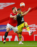 Football - 2019 / 2020 Premier League - Manchester United vs Southampton<br /> <br /> Harry Maguire of Manchester United and Che Adams of Southampton  at Old Trafford<br /> <br /> COLORSPORT/LYNNE CAMERON
