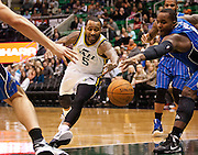 Jazz guard Mo Williams (5) dives for a loose ball in the lane during the first half of the NBA basketball game between the Utah Jazz and the Orlando Magic at Energy Solutions Arena, Wednesday, Dec. 5, 2012.