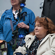 The funeral of former Prime Minister Margaret Thatcher who died Monday April 8. Mourners withblue roses