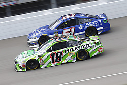 August 12, 2018 - Brooklyn, Michigan, United States of America - Kyle Busch (18) and BJ McLeod (51) battle for position during the Consumers Energy 400 at Michigan International Speedway in Brooklyn, Michigan. (Credit Image: © Chris Owens Asp Inc/ASP via ZUMA Wire)