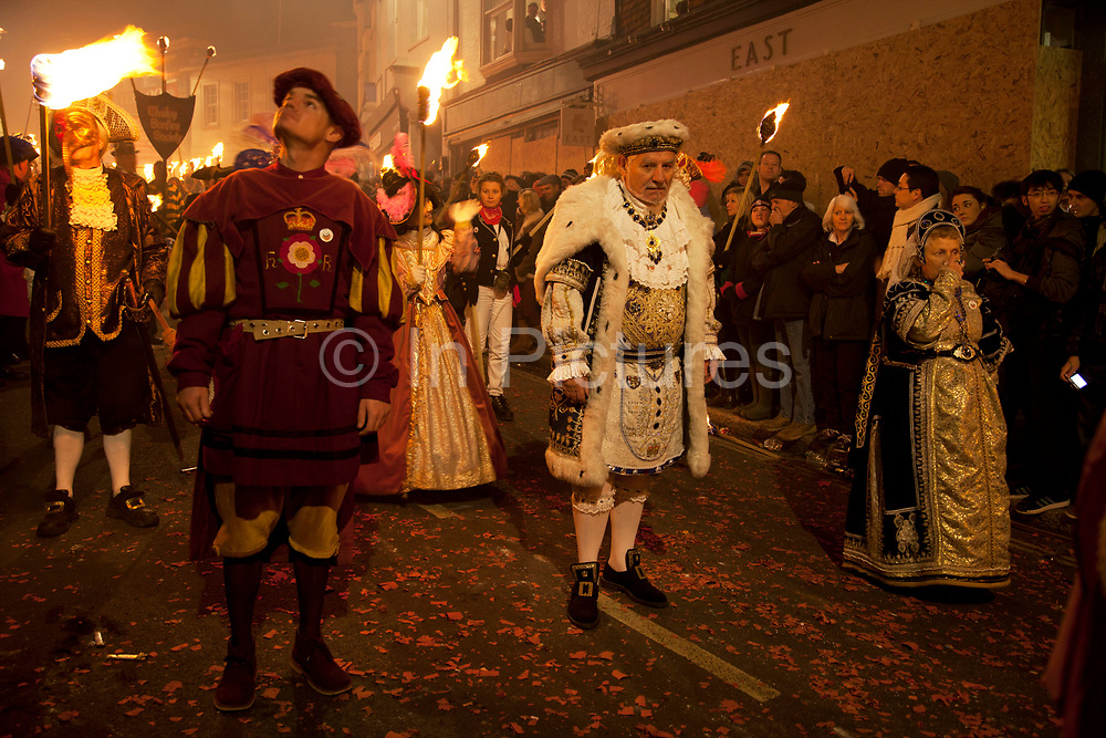 Lewes, UK. Monday 5th November 2012. Society members dressed in period costumes as royalty. Bonfire Night celebration in the town of Lewes, East Sussex, UK which form the largest and most famous Guy Fawkes Night festivities. Held on 5 November, the event not only marks the date of the uncovering of the Gunpowder Treason and Plot in 1605, but also commemorates the memory of the 17 Protestant martyrs from the town burnt at the stake for their faith during the Marian Persecutions of 1555–57. There are six bonfire societies putting on parades involving some 3,000 people.