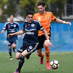 BRISBANE, AUSTRALIA - NOVEMBER 12: Christian Theoharous of the Victory is tackled by Shannon Brady of the Roar during the round 1 Foxtel National Youth League match between the Brisbane Roar and Melbourne Victory at Spencer Park on November 12, 2016 in Brisbane, Australia. (Photo by Patrick Kearney/Brisbane Roar)