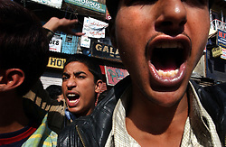 """Kashmiri youth scream """"We want freedom"""" during a protest in the streets of Srinagar on September 24. Few people braved anti-poll violence in Kashmir's main city to vote in a state election after an early morning gun battle between Indian Border Security Forces and suspected Muslim militants."""