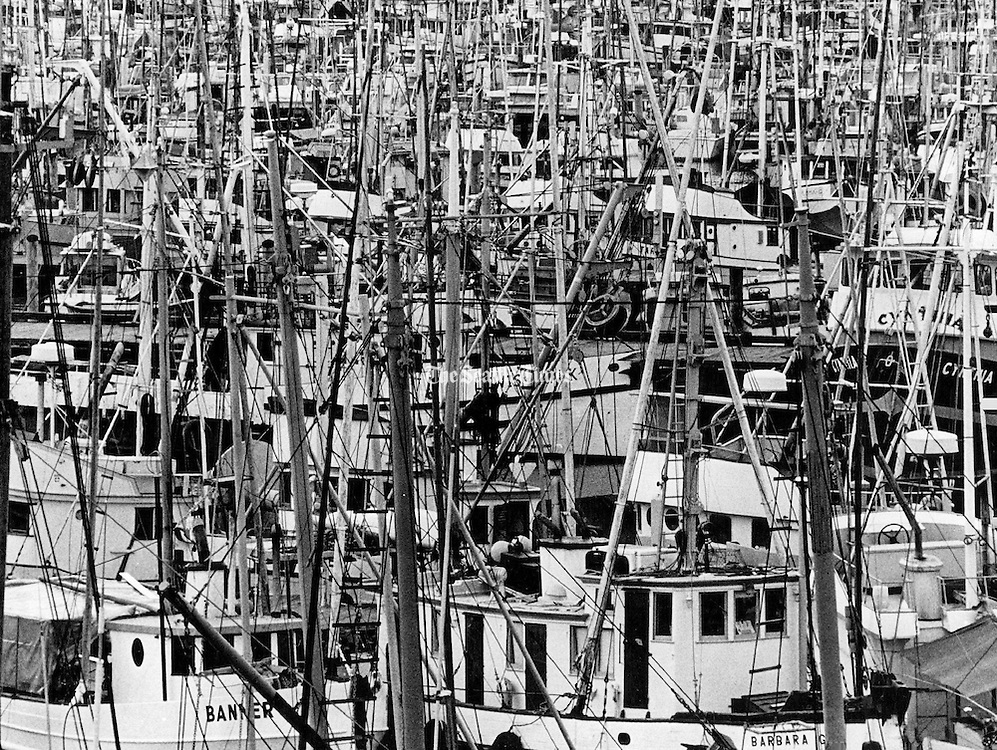 The west walkway of the Ballard Bridge overlooked a forest of masts, ropes, chains and chocks at Fisherman's Terminal in Seattle. <br /> (Peter Liddell / The Seattle Times, 1978)