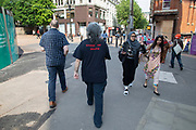 Man wearing a t-shirt for the heavy metal band Obituary, which reads Cause of Death in Birmingham, United Kingdom.