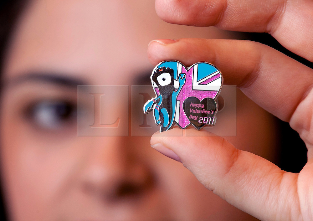 © under licence to London News Pictures. Collectors have been rushing to buy one of the most unusual Valentine gifts made this year. The only company allowed to make the official Olympic pin badges has decided to make a special one for Valentines day a year earlier in 2011. The collectors item, only 2012 sets will be made, depicts the Olympic mascots Wenlock and Mandeville. There will be 2012 different designs of Olympic pin badges produced, keen collectors are buying each one as they appear, in the knowledge that a full set will be the collectable item of the future. Picture shows Rosie Moth holding the badges. Picture credit: Dave Warren/London News Pictures.