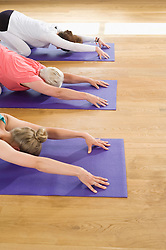 Close-up three women fitness Yoga stretching