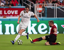 July 31, 2018 - Miami Gardens, Florida, USA - Real Madrid C.F. forward Gareth Bale (11) drives the ball into the goal area defended by Manchester United F.C. defender Luke Shaw (23) during an International Champions Cup match between Real Madrid C.F. and Manchester United F.C. at the Hard Rock Stadium in Miami Gardens, Florida. Manchester United F.C. won the game 2-1. (Credit Image: © Mario Houben via ZUMA Wire)