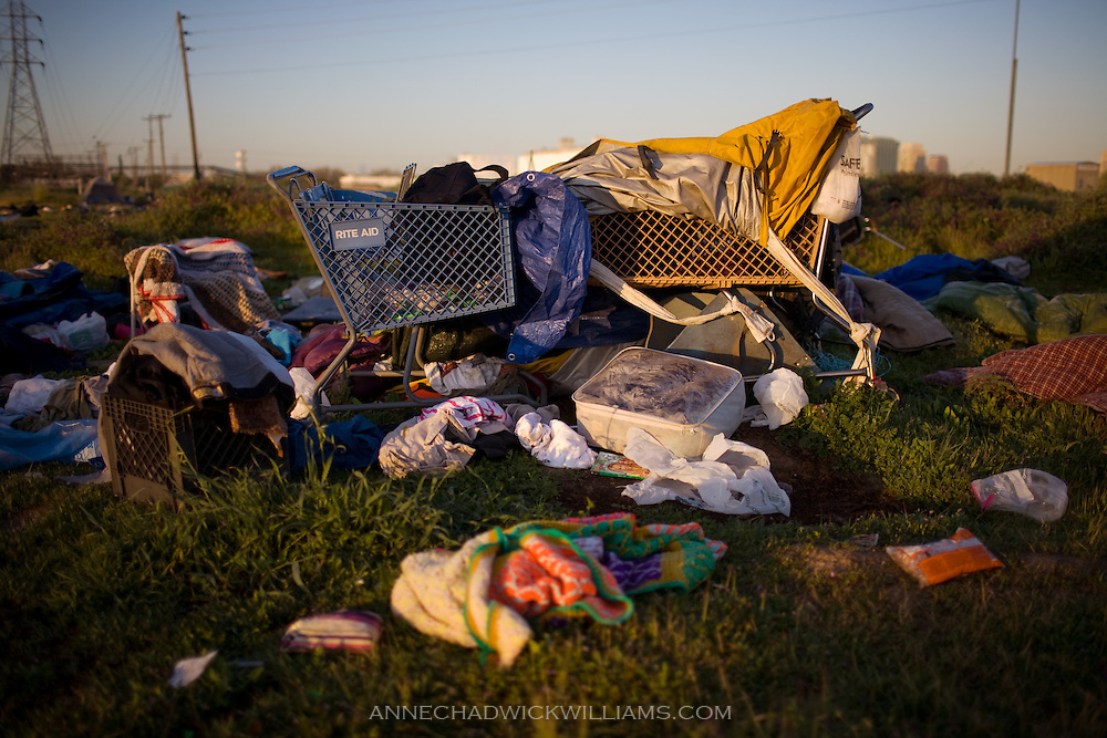 Shopping carts and clothes remain after Sacramento homeless are forced to move from a tent city.
