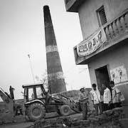 Vaccinators approach the Munshi (supervisor) at a brick kiln asking about the eligible children. Khagaria, Bihar.