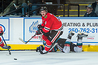 KELOWNA, CANADA - APRIL 8: Lucas Johansen #7 of the Kelowna Rockets is checked to the ice by Ryan Hughes #19 of the Portland Winterhawks on April 8, 2017 at Prospera Place in Kelowna, British Columbia, Canada.  (Photo by Marissa Baecker/Shoot the Breeze)  *** Local Caption ***