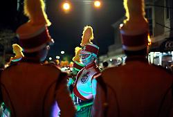 13 Feb 2015. New Orleans, Louisiana.<br /> Mardi Gras. Krewe D'Etat prepares to make its way along Magazine Street. Marching Band members prepare for the parade.<br /> Photo; Charlie Varley/varleypix.com
