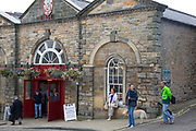 Richmond is a market town and the centre of the district of Richmondshire. Historically in the North Riding of Yorkshire, it is situated on the edge of the Yorkshire Dales National Park. North Yorkshire, England, UK. The Market Hall in Trinity Church Square.