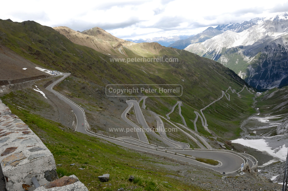 Italy, June 19 2015: View in the direction of Bormio of the Strada Statali 38 from near the top of the Passo dello Stelvio (Stelvio Pass) mountain pass. The road is the highest paved mountain pass in the Eastern Alps at an elevation of 2,757m above sea level. Copyright 2015 Peter Horrell.