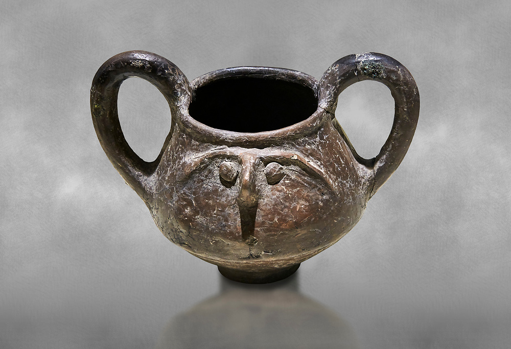 Hittite terra cotta double handled jug with a relief human face- 17th - 16th century BC - Hattusa ( Bogazkoy ) - Museum of Anatolian Civilisations, Ankara, Turkey . Against grey art background .<br /> <br /> If you prefer to buy from our ALAMY STOCK LIBRARY page at https://www.alamy.com/portfolio/paul-williams-funkystock/hittite-art-antiquities.html  - Type Hattusa into the LOWER SEARCH WITHIN GALLERY box. Refine search by adding background colour, place, museum etc<br /> <br /> Visit our HITTITE PHOTO COLLECTIONS for more photos to download or buy as wall art prints https://funkystock.photoshelter.com/gallery-collection/The-Hittites-Art-Artefacts-Antiquities-Historic-Sites-Pictures-Images-of/C0000NUBSMhSc3Oo