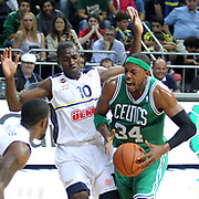 Fenerbahce Ulker's Romain Sato (L) and Boston Celtics's Paul Pierce (C) during their NBA Europe Live 2012 The four-game tour tips match Fenerbahce Ulker between Boston Celtics at Fenerbahce Ulker Sports Arena in Istanbul, Turkey, Friday, October 05, 2012. Photo by TURKPIX