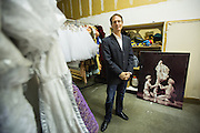 Bay Pointe Ballet Artistic Director Bruce Steivel poses for a portrait amongst original costumes from Nevada Ballet Theatre during Nutcracker costume fittings at Bay Pointe Ballet in South San Francisco, California, on October 27, 2013. (Stan Olszewski/SOSKIphoto)