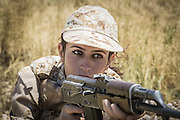 Sulaymaniyah, Iraq - <br /> <br /> Female Fighters of The Peshmerga<br /> As ISIS has swept across northern Iraq, they have become known for their atrocities towards women. However, there's a group of women that aren't preparing to flee ISIS but instead are preparing to meet them with their AK-47s. The 2nd Peshmerga, are a battalion of Kurdish fighters 'Äì and they just happen to be an all-female soldiers. They're front line troops, some of whom have been fighting for years, and they are eager to face ISIS. Dressed in army fatigues and armed with rifles, they are ready to lay down their lives to protect the Kurdish homeland against the threat of ISIS. They carry out training exercises and look no different from other Kurdish soldiers - except for a hint of makeup on some faces and long hair escaping from their caps. The 2nd Battalion consists of 550 mothers, sisters and daughters and was formed in 1996. Over the past month, they have moved into disputed areas abandoned by Iraqi security forces during the Isis advance. They have also recently seized control of oil production facilities at Bai Hassan and Kirkuk - the female Peshmerga will now be part of a mission to secure the city and its surrounding oil fields.<br /> <br />  A woman Peshmerga of the 2nd Battalion takes part in a military exercise.<br /> ©Excluisvepix Media