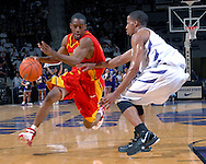 Iowa State guard Corey McIntosh (L) drives to the basket against pressure from Kansas State guard Clent Stewart (R) in the first half at Bramlage Coliseum in Manhattan, Kansas, February 17, 2007.  K-State leads the Cyclones at halftime 22-20.