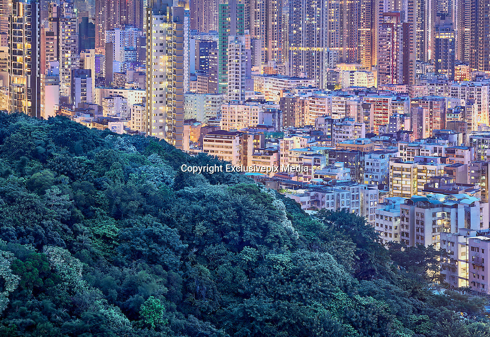 The Blue Moment<br /> <br /> Each day at the very last moment of dusk, the sky takes on a deep blue tinge which is then reflected onto everything that is below. During this very brief moment that only lasts a minute or two a blue veil envelops Hong Kong and releases a mystical atmosphere.<br /> <br /> Photographer Romain Jacquet-Lagreze 'For me, photography is a way to cast fleeting moments in still images. Moments don't last; places and people disappear in time. One particular day I was shooting the city at sunset, bright light washed out most of the colors, you could feel the heat through the images. I decided to stay a little longer to watch the sun going down and the city lighting up. I witnessed how just for few minutes the city was enveloped in a deep blue haze. The blueness projected itself ferociously onto the buildings that looked colorless just a little while before. I was deeply impressed. The only way to eternalize this ephemeral moment was with my camera.'<br /> <br /> The surreal character of his blue-laced imagery is enhanced by the composition: structures and nature are framed as they were cut up and put together. The density of the city is mirrored by nature that's as intense.<br /> ©Romain Jacquet-Lagreze/Exclusivepix Media