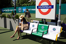 A general view of branding at Southfields station during day one of the Wimbledon Championships at the All England Lawn Tennis and Croquet Club, Wimbledon. Photo credit should read: Katie Collins/EMPICS