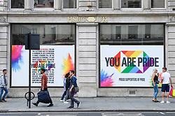 © Licensed to London News Pictures. 01/07/2019. LONDON, UK.  The HSBC bank on Regent Street is one of many retail stores in the capital's West End whose exteriors are decorated in rainbow colours in support of Pride Month.  Pride is an annual celebration of the LGBT+ community and culminates in the LGBT+ parade in the UK, with thousands of people travelling the route either by foot or on floats.  Photo credit: Stephen Chung/LNP