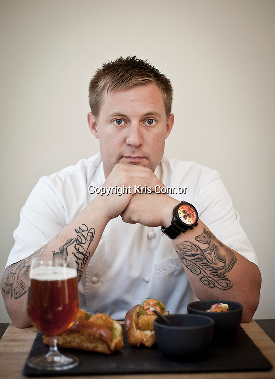 Chef Bryan Voltaggio poses for a photo with his take on the Oyster po'boy, which will soon be served at his restaurant Family Meal in Frederick, Md. on July 12th, 2012. Photo by Kris Connor for The Daily
