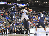 Mar 22, 2013; Kansas City, MO, USA; North Carolina Tar Heels guard P.J. Hairston (15) drives to the basket against Villanova Wildcats forward Mouphtaou Yarou (13) in the first half during the second round of the 2013 NCAA tournament at the Sprint Center. Mandatory Credit: Peter G. Aiken-USA TODAY Sports