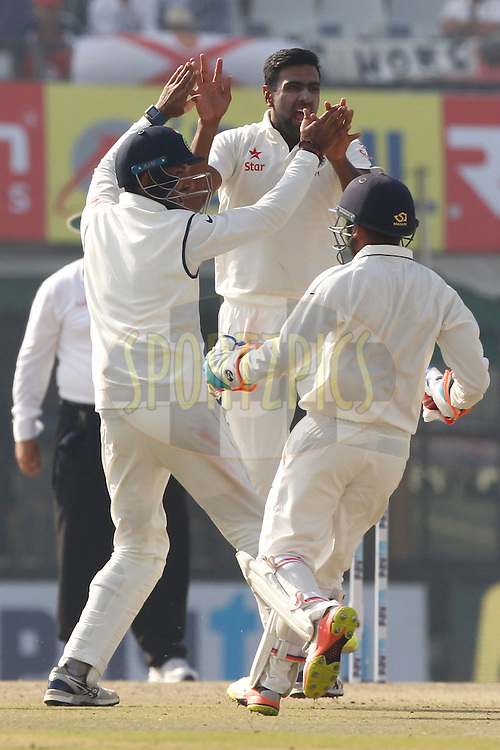Ravichandran Ashwin of India celebrates the wicket of Alastair Cook Captain of England during day 1 of the third test match between India and England held at the Punjab Cricket Association IS Bindra Stadium, Mohali on the 26th November 2016.<br /> <br /> Photo by: Deepak Malik/ BCCI/ SPORTZPICS