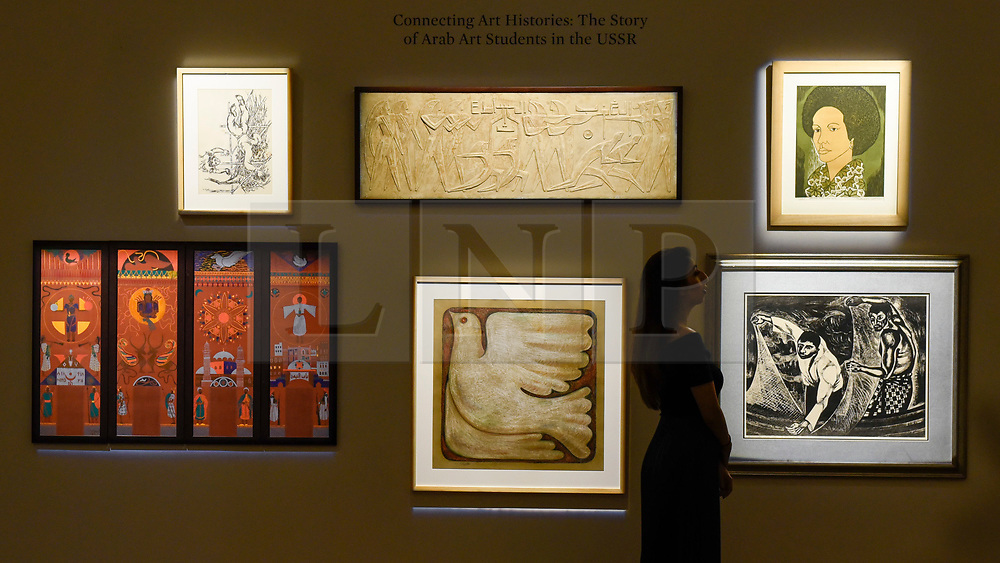 """© Licensed to London News Pictures. 18/10/2019. LONDON, UK. A collection of works by Arab students in the USSR, including (top right) """"Alem"""", 1978, by Thuraya Al-Baqsami (Est. GBP6,000-8000), one of the first female Arab students to join the Surikov Moscow Institute of Art. Preview of Islamic, Indian and Middle Eastern art to be auctioned at Sotheby's, New Bond Street, on 22 and 23 October.  Photo credit: Stephen Chung/LNP"""