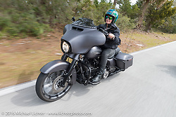 Mandy Campbell Rossmeyer (L) and Shelly Rossmeyer of Rossmeyer Harley Davidson riding through Tomoka State Park during Daytona Bike Week 75th Anniversary event. FL, USA. Thursday March 3, 2016.  Photography ©2016 Michael Lichter.