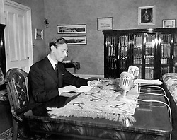 Embargoed to 2100 Friday May 08 File photo dated 24/05/39 of King George VI giving an Empire Day broadcast from Government House in Winnipeg. The Queen reflected on her father's VE Day message in her own address which was broadcast at exactly the same moment three-quarters of a century apart.