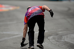 October 21, 2018 - Gold Coast, QLD, U.S. - GOLD COAST, QLD - OCTOBER 21: Track marshall picks up a car part at The 2018 Vodafone Supercar Gold Coast 600 in Queensland, Australia. (Photo by Speed Media/Icon Sportswire) (Credit Image: © Speed Media/Icon SMI via ZUMA Press)