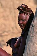 Himba woman in traditional dress Kaokoland Namibia